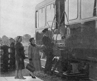 A pram being loading into a railbus